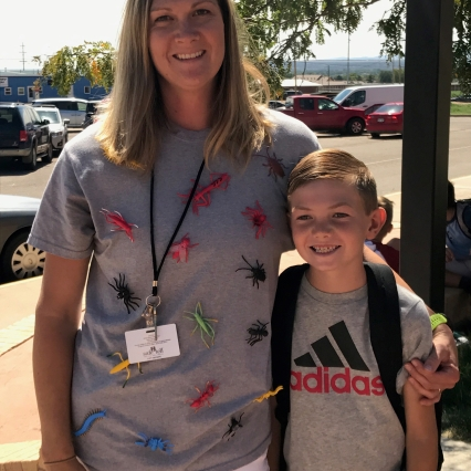"Mrs. James and her son on the first day of school. Mrs. James is sporting and insect shirt to kick off her conceptual unit. Most of our teachers dress up to ""hook"" their students into the new unit at the beginning of each quarter."