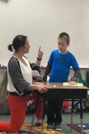 Mrs. Hartman providing feedback after a presentation
