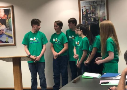 The DI team presenting to the school board.